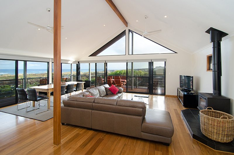 Overhead fans, louvres to capture the fabulous sea breeze. High ceilings.  Very cool in summer.