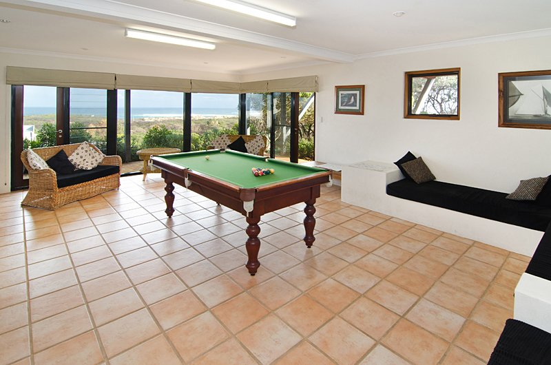 Huge games room downstairs. Lounges, TV for dvds .  Magic ocean views.