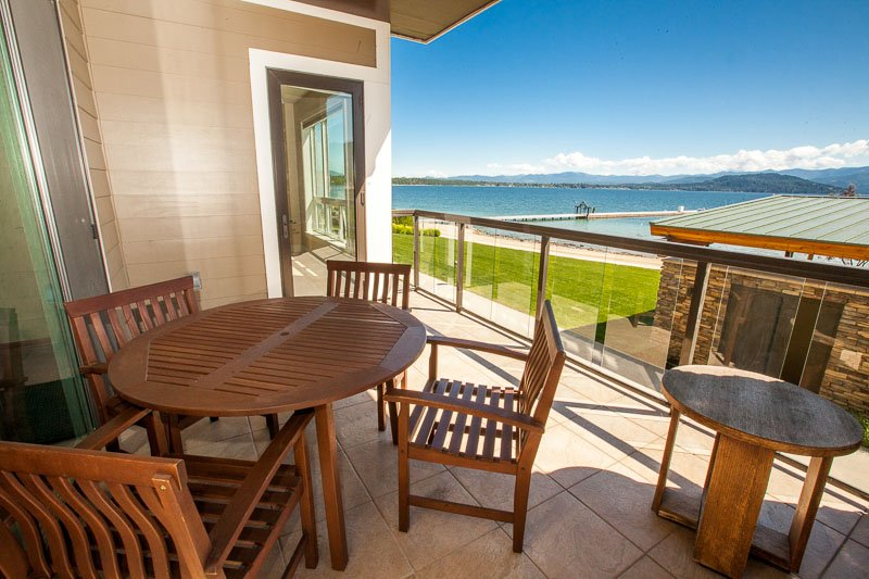 Covered deck with walkout to beach and pool
