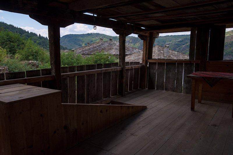Wooden terrace on first floor.