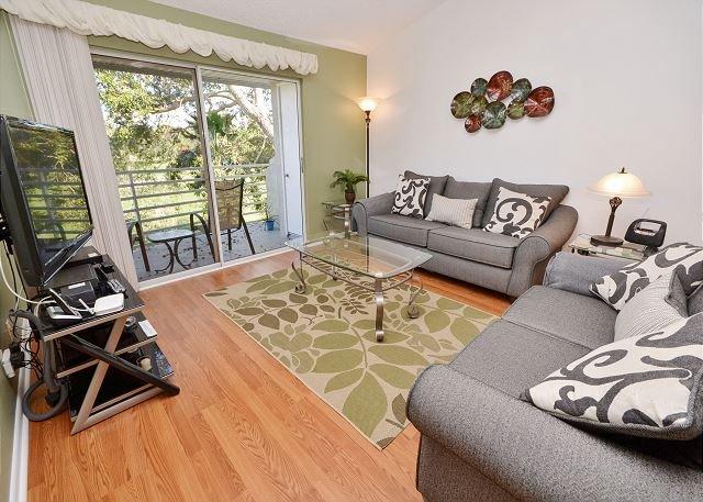 Living room with sleeper sofa and balcony