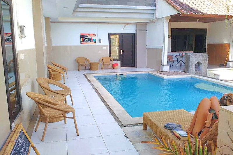 Quaint swimming pool in the complex is 15 meters from your room. Nice to cool off in relax by.