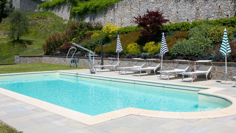 large pool with pool hoist and graduated steps
