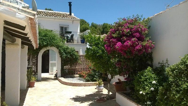 The terrace overlooks the garden