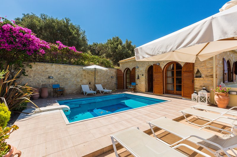 Private swimming pool with sun beds & umbrellas by the pool