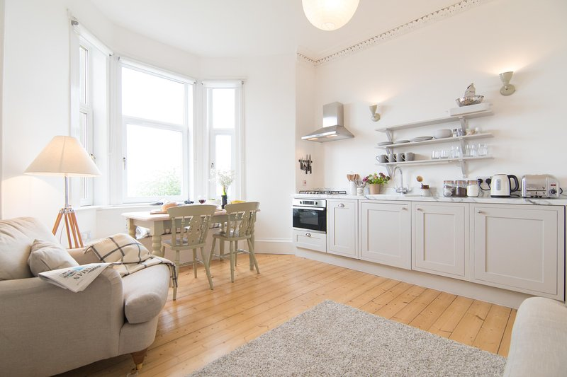 light and airy living room/kitchen with views over the beach and to Arran