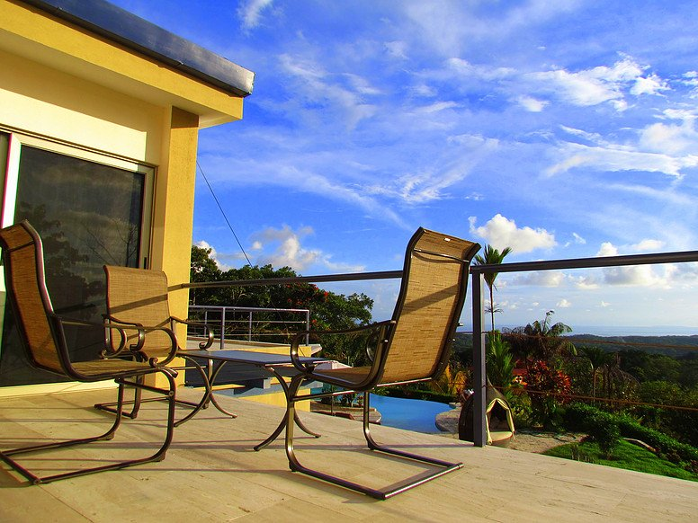 Upper level balcony and patio furniture.