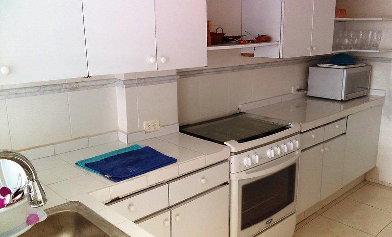 Complete kitchen with adjacent maids quarters