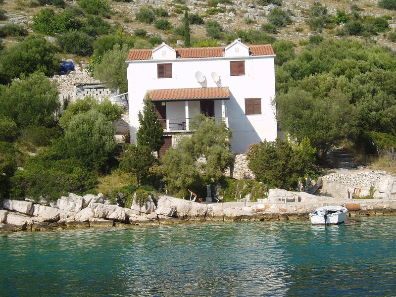 Our house taken from a boat in Skrivena Luka bay.