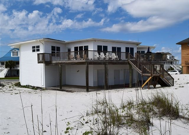 The gulf side of the home offers and expansive deck and access to the beach.