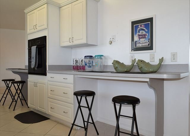 The kitchen is perfect for entertaining, with kitchen bar seating.