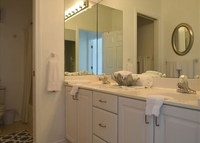 Bedroom 1's private bath has 2 sinks and a tub/shower combo.