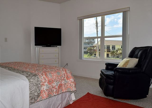 Bedroom 2 also has a TV and recliner.