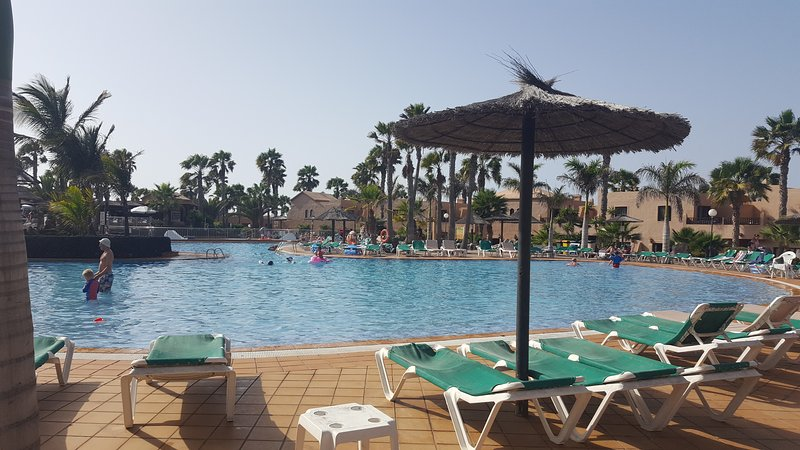 Pool area at Oasis Dunas