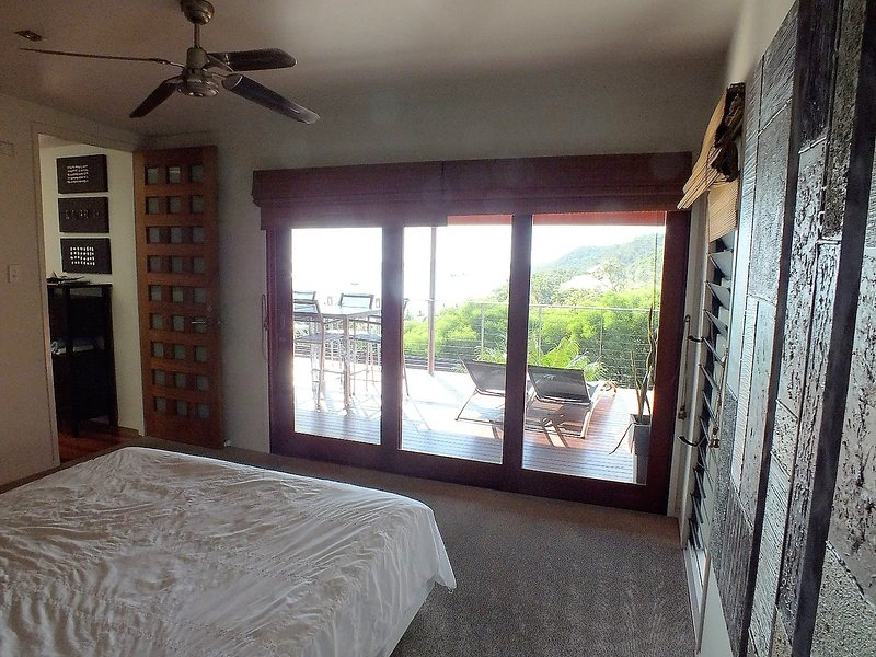 Mid Level - Master King Bedroom 1 with access to deck and views!