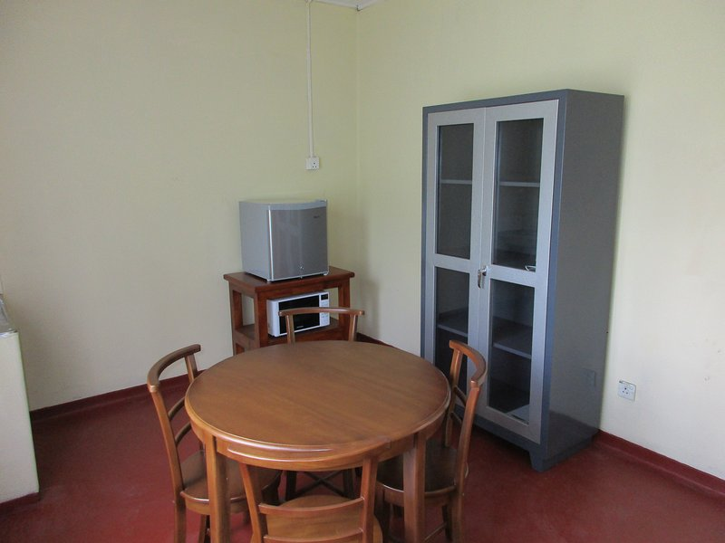 Kitchen with bar fridge and Microwave