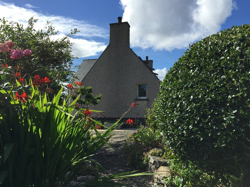 The cottage is surrounded by a lovely garden