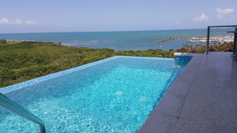 Stunning Infinity Views and an Infinity Pool Seasonal Rental, holiday rental in Luis M. Cintron