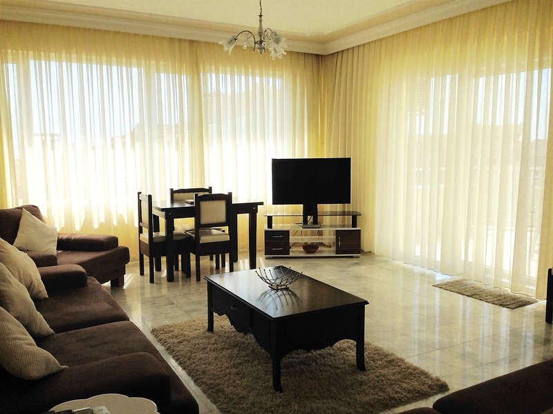 Living Room. Patio doors to right lead to balcony with views towards Ladies Beach and swimming pools