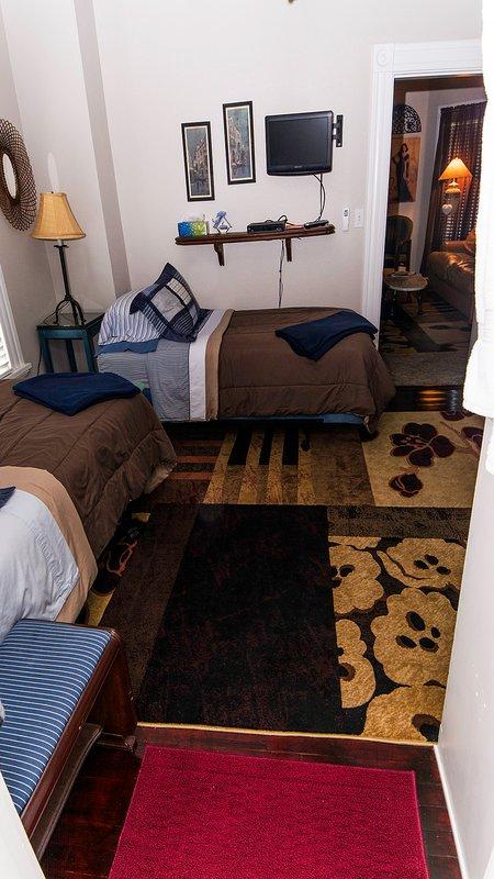 Suite 3 dispose d'une chambre latérale w / 2 lits jumeaux.