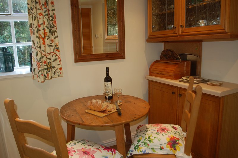 The kitchen has a dining space for two