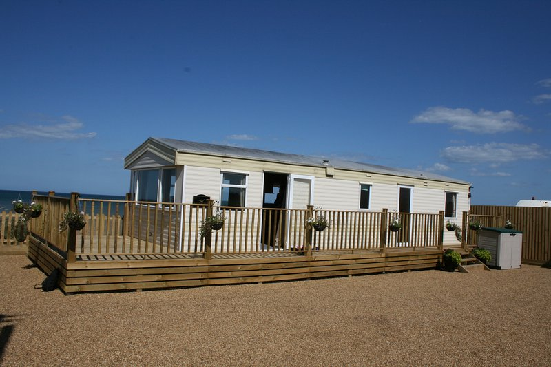 Sandbank, Bacton, sits proudly above the beach, any closer and you'll get your feet wet!