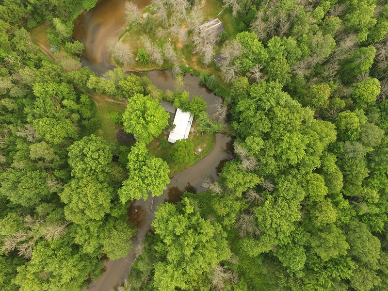 Aerial view of our Riverbend cabin in the woods