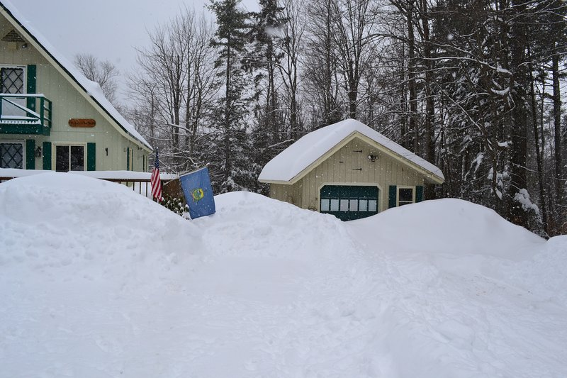Detached garage which can house up to 12 snowmobiles.