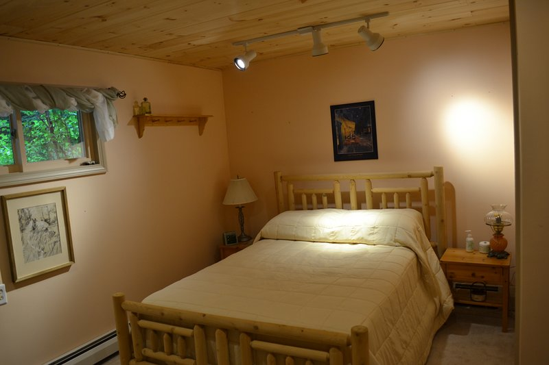 Queen size bed in what we call the Knotty Pine room.