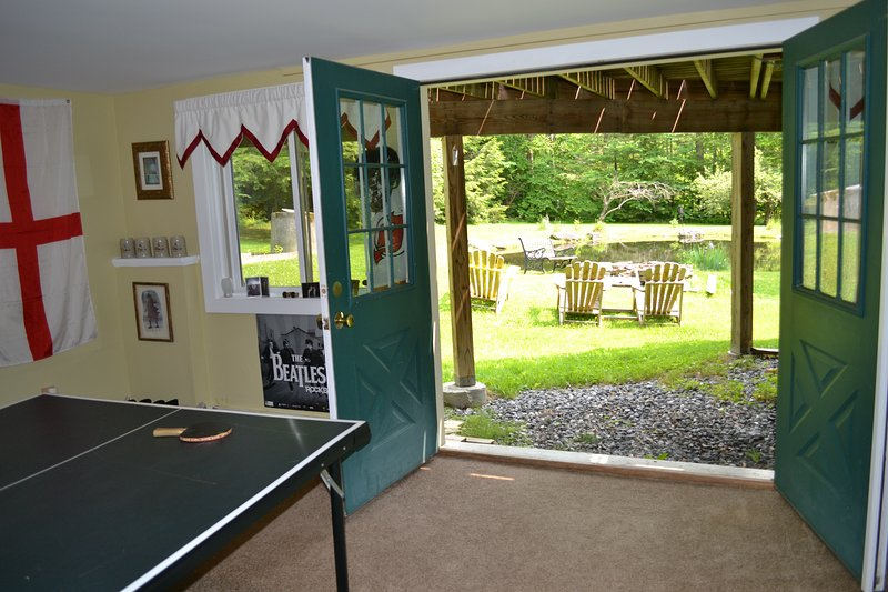 Double doors from game room to fire pit next to Frog Pond.