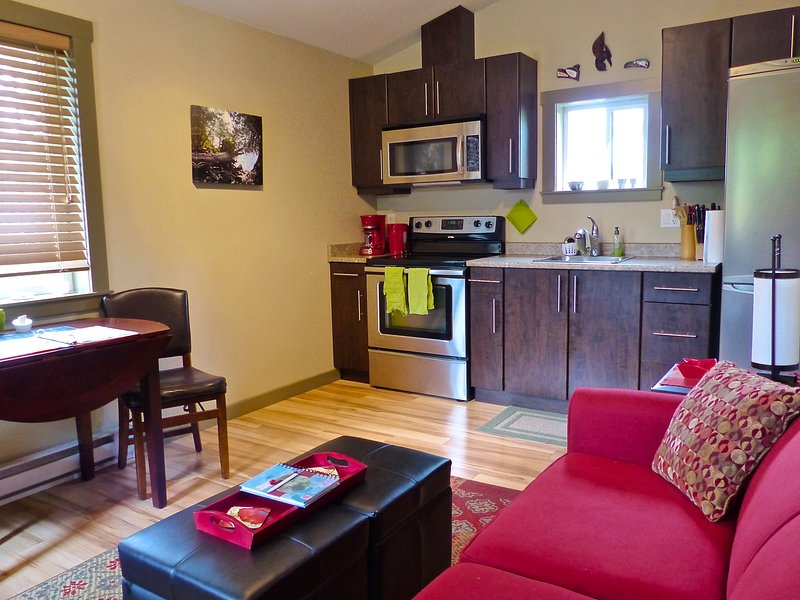 Kitchen/Living area with full stove & oven,  and full Fridge & Freezer