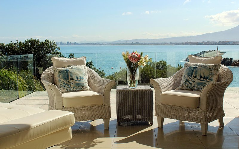 The Views balcony with Somerset-West, Gordon's Bays Old Harbour and Harbour Island in the background