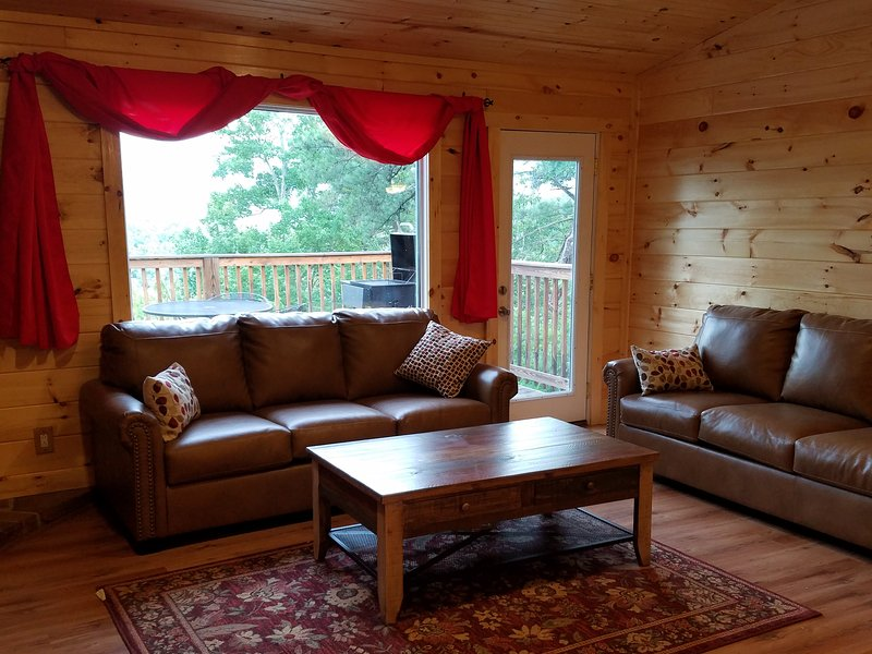 two full size leather sofas provides ample seating for everyone.....all with a wonderful mtn. view.