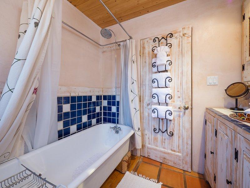Hundidos, bañera con patas con ducha