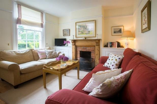 sitting room with open fireplace