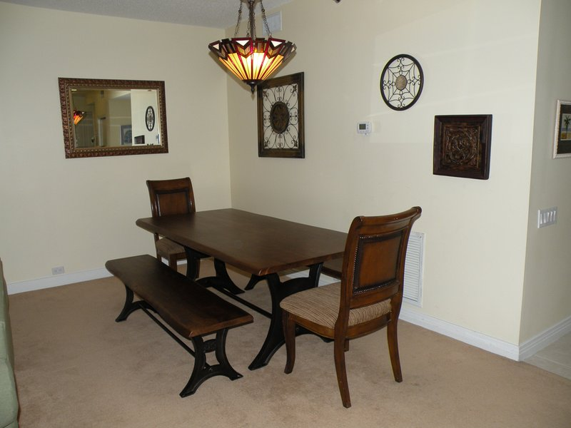 Adjacent dining area comfortably seats 8-10