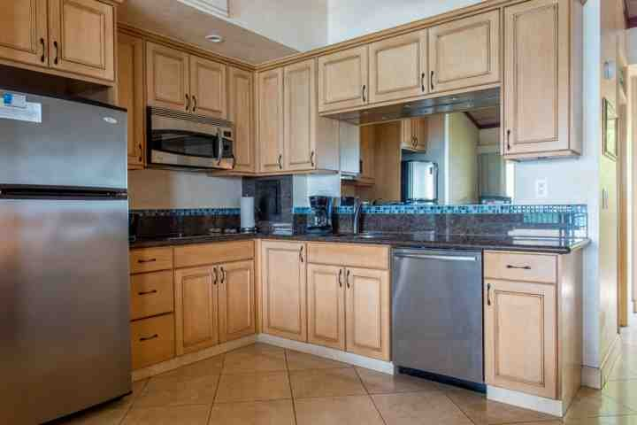 Granite counter tops and plenty of cabinet space.