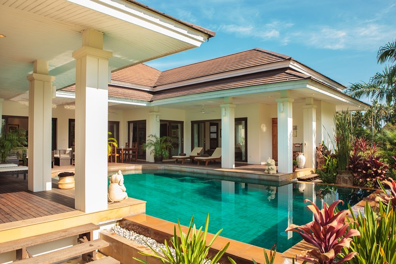 Beautiful pool villa with natural wood deck