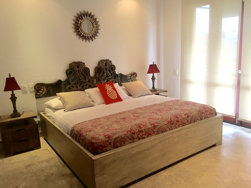 Master bedroom with king size bed, twin trundle (not shown), and balcony