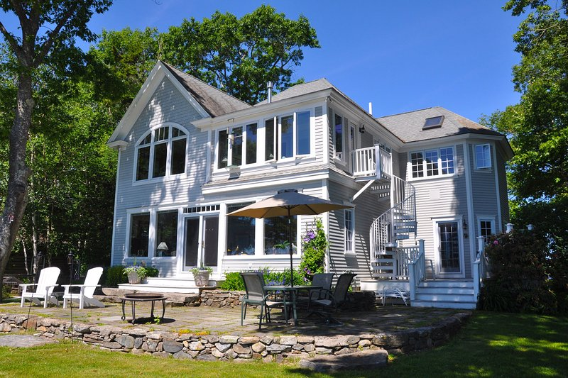 Spacious oceanfront home sits directly on Casco Bay.