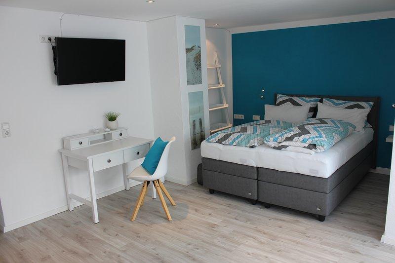 Cómoda sala de estar / dormitorio con el FRU Boxspringbed