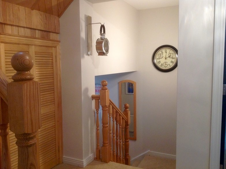 The apartment has its own front door and is spread over 2 floors.
