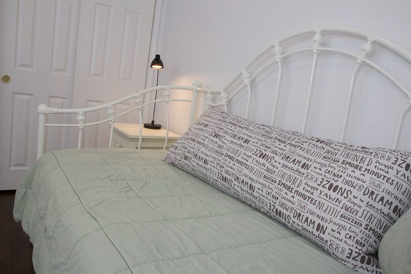 Whimsical 3rd bedroom with comfortable daybed and full-body pillow.