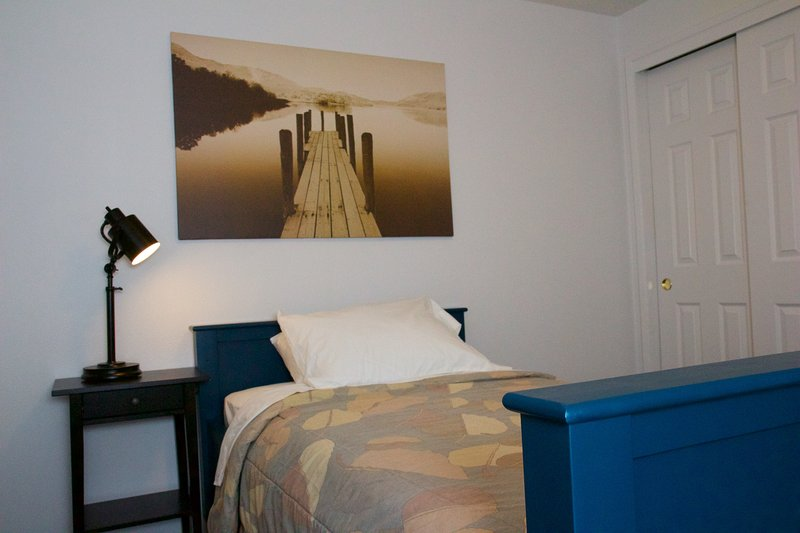 4th bedroom is clean and comfortable with twin-sized mattress and memory-foam pillow.