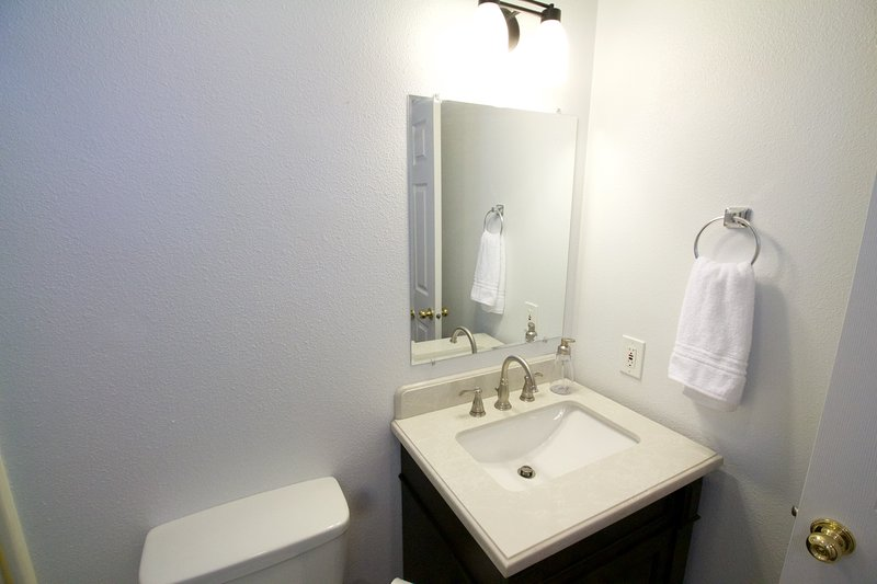 2nd full bathroom with brand-new fixtures, bright LED lighting throughout.