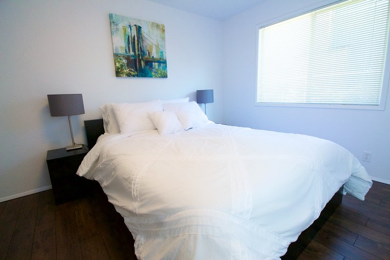Light and Bright Master Bedroom with Queen-sized memory foam mattress. USB charge outlets.