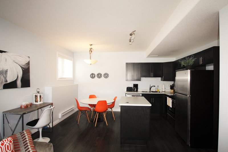 Kitchen/Dinning -Modern design with ample cooking space.  Note the Laptop workspace near outlet for