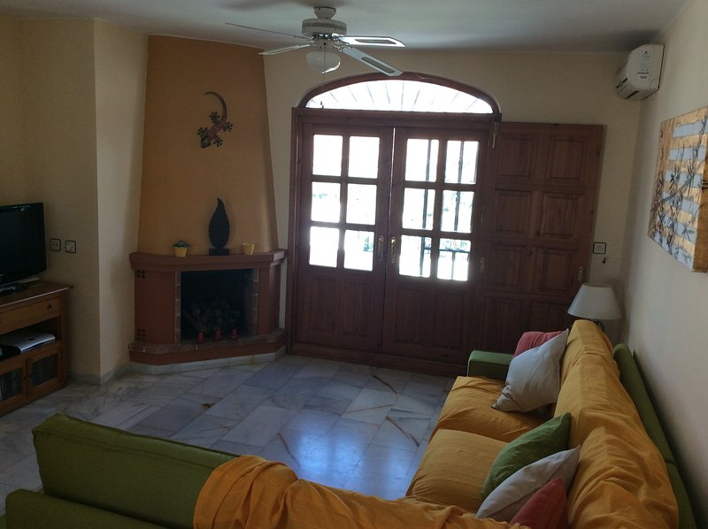 Large living area with access to rear terrace