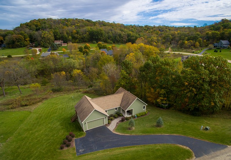 Nestled in beautiful Cogan Valley this home will afford you great views and tons of Galena memories.