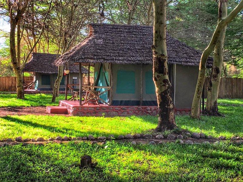 A Campsite and Tented Camp that is in Wilderness, aluguéis de temporada em Arusha (região)